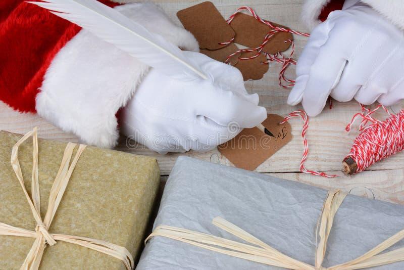 Santa Writing Gift Tags images stock