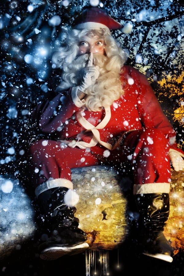 Santa y nieve imagen de archivo
