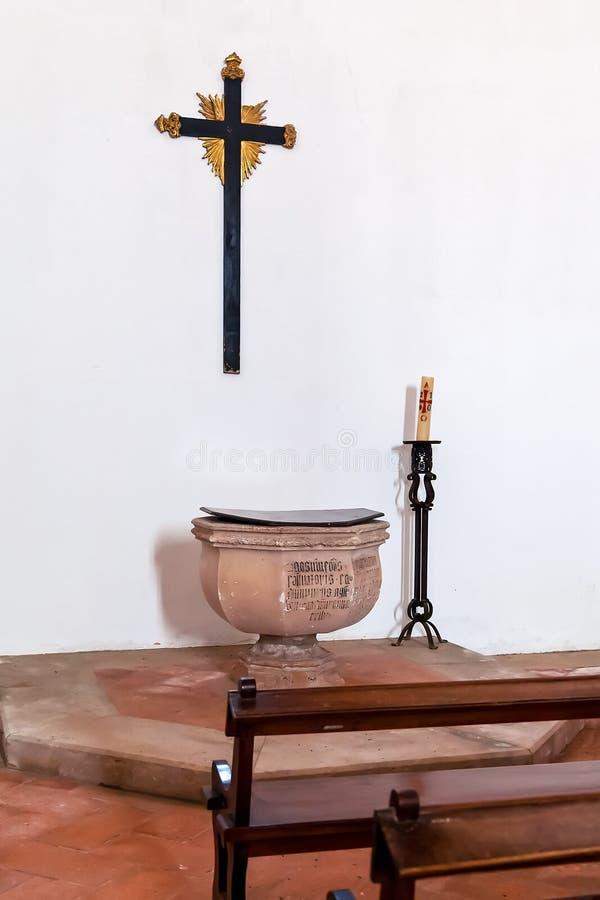 Santarem, Portugal - Gothic Baptismal Font, cross or crucifix and pews royalty free stock image