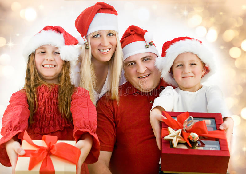 Santas 5. Young family with gifts at christmas royalty free stock images