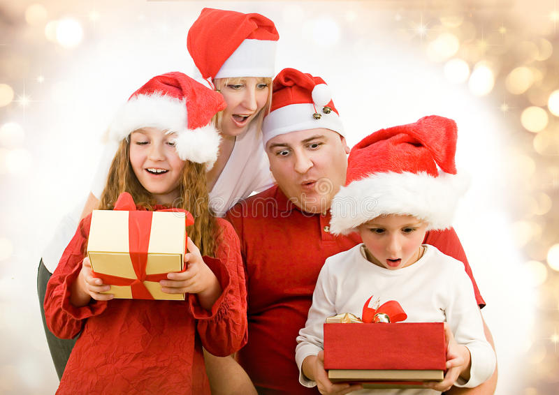 Santas 6. Young family with gifts at christmas stock photo