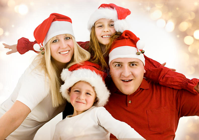 Santas 7. Young family with gifts at christmas royalty free stock photography