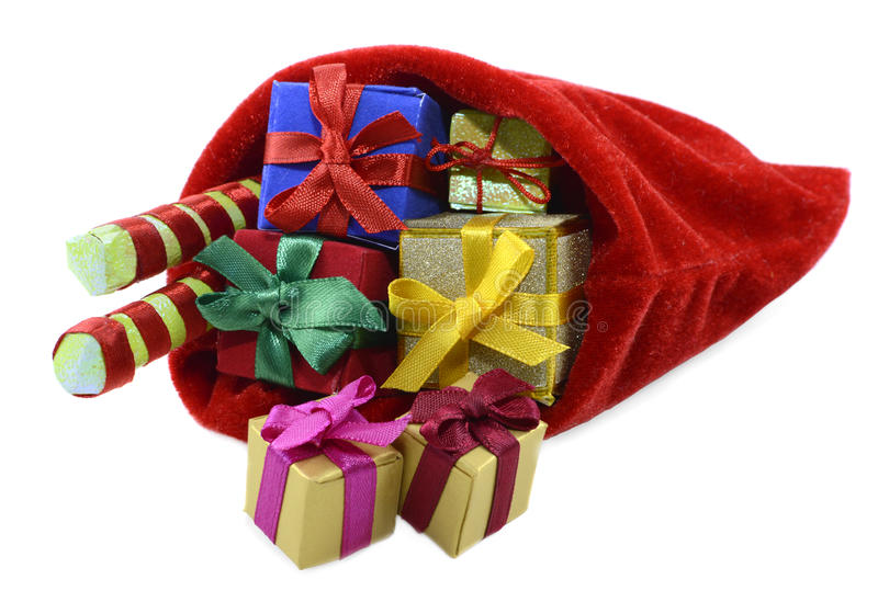 Santas bag with gifts. Santas red bag full of colorful gifts isolated royalty free stock image