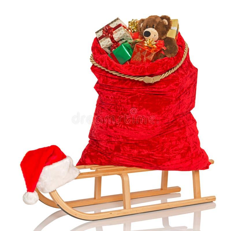 Santas despiden en el trineo aislado imagenes de archivo