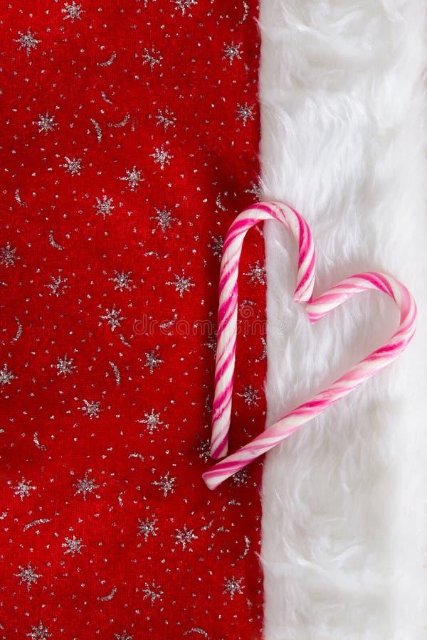 Santas hatt- och godisrottingar arkivfoto