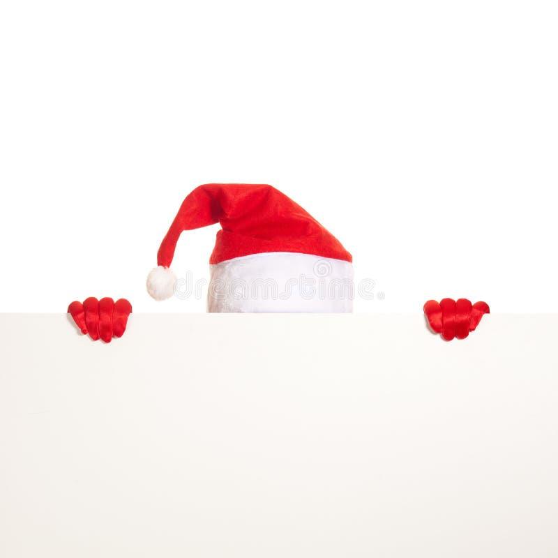 Santas lock och händer i röda handskar rymmer mellanrumet arkivbild
