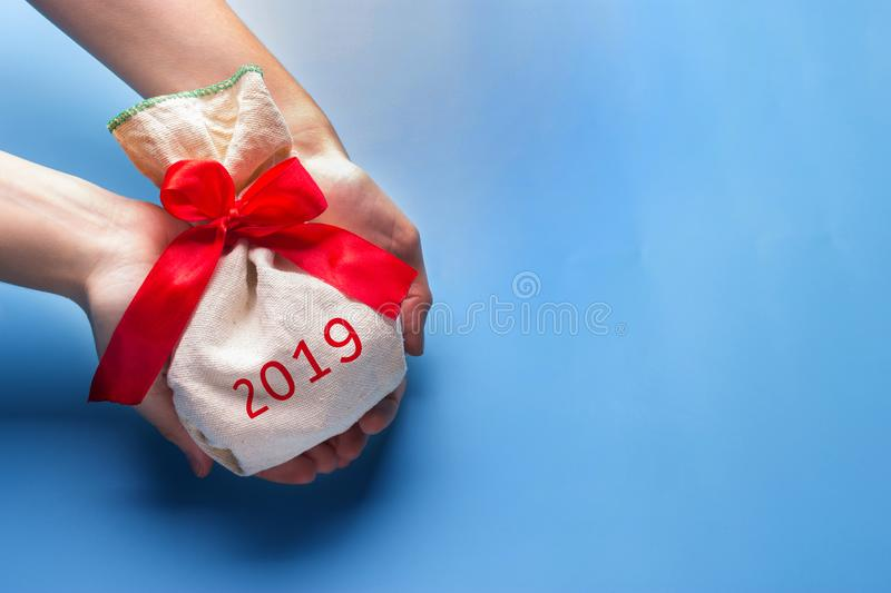 Santas red bag standing alone against blue background stock photo