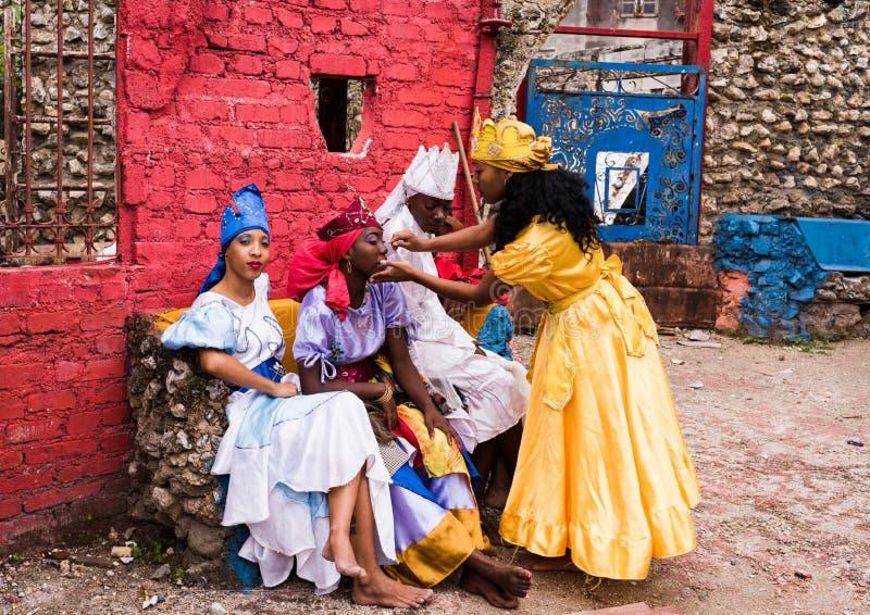 Santeria Dancers - Callejon de Hamel / Hamel Alley. Havana, Cuba / March 20, 2016: Four Cuban women prepping before Santeria performance at Hamel Alley stock photo