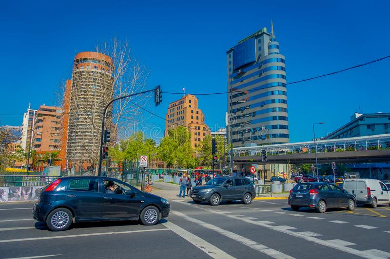 SANTIAGO, CHILE - OCTOBER 16, 2018: Outdoor view of cars in the street circulating in the financial center buildings. Skyline of Santiago de Chile in a gorgeous royalty free stock image