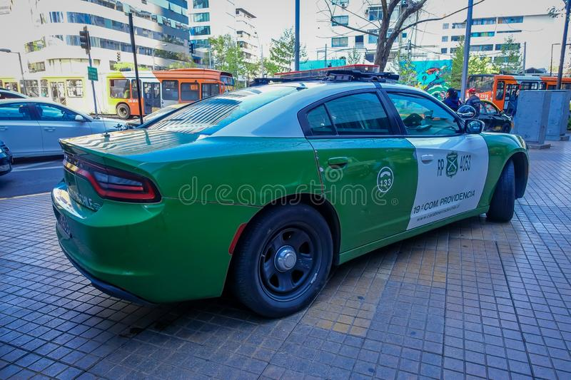 SANTIAGO, CHILE - OCTOBER 16, 2018: Outdoor view of green Police carabineros car parked in the city streets. Of Santiago, Chile stock image