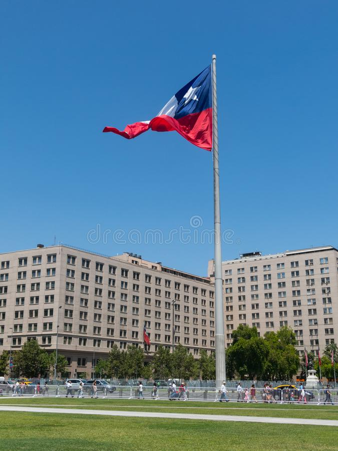 Chileans walking near the giant flag on Avenida La Alameda with royalty free stock image