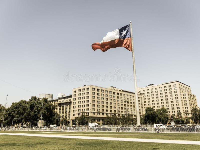 Chileans walking near the giant flag on Avenida La Alameda with royalty free stock photography