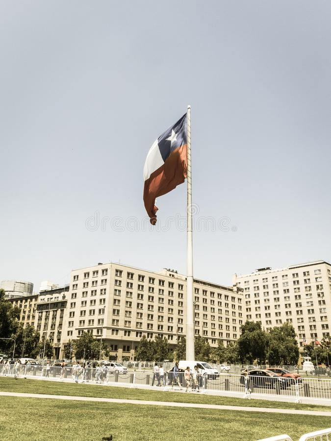 Chileans walking near the giant flag on Avenida La Alameda with stock photography