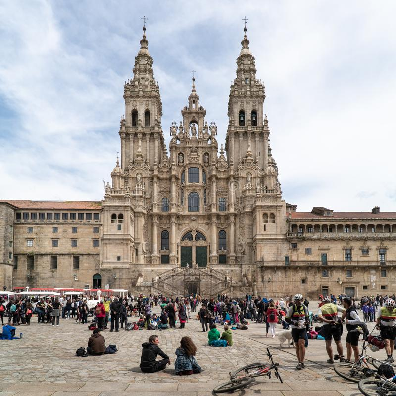 Santiago de Compostela Cathedral and lots of tourists and pilgrims in holiday. Santiago de Compostela, Spain; April 19, 2019: Santiago de Compostela Cathedral royalty free stock image
