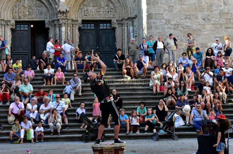 Santiago de Compostela, Spain. August 2018. Cathedral and fire eater. Summer Festival, Platerias facade. stock photo