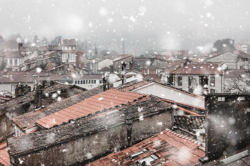 Santiago de Compostela Spain cityscape in snowfall. Santiago de Compostela, Spain, cityscape in snowfall at winter. Christmas mood. Pastel trendy toning royalty free stock images