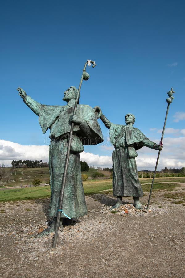 Statues of Pilgrims on the Monte do Gozo in Santiago de Compostela, Spain. Santiago de Compostela, Spain. February 10 2019: Statues of Pilgrims looking at the stock image