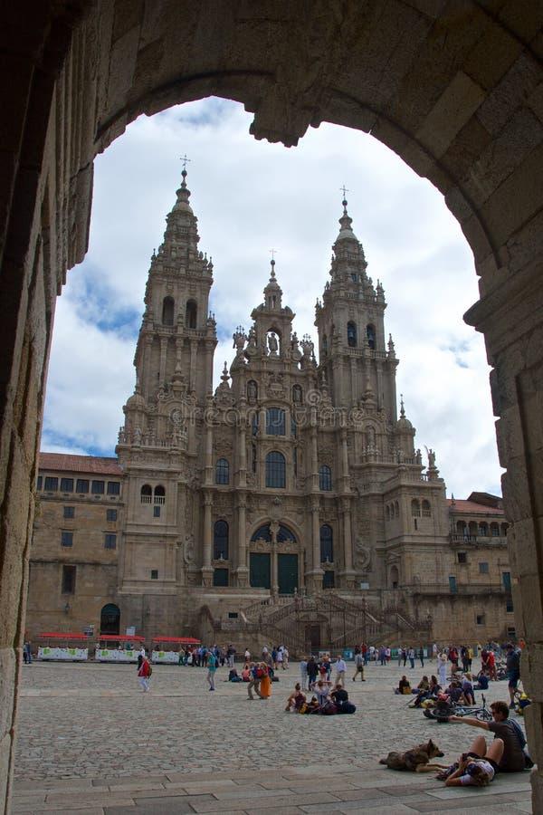 Santiago de Compostela, Spain - September 2018: Pilgrims reaching the destination of Camino de Santiago at Santiago de Compostela stock image