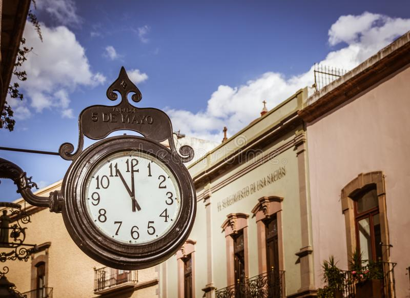 Traditional clock in Andador 5 de Mayo in Queretaro Mexico. SANTIAGO, QUERETARO / MEXICO - 06 22 2017: Traditional clock in Andador 5 de Mayo in Queretaro Mexico royalty free stock images