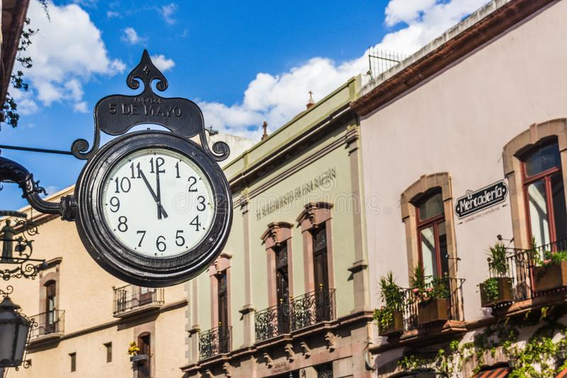 Traditional clock in Andador 5 de Mayo in Queretaro Mexico. SANTIAGO, QUERETARO / MEXICO - 06 22 2017: Traditional clock in Andador 5 de Mayo in Queretaro Mexico stock photos