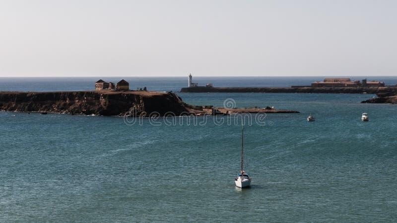 Santiago. View of the islet of Santa Maria and the background Lighthouse Dona Maria Pia in Ponta Temerosa, Santiago, Cape Verde royalty free stock photo
