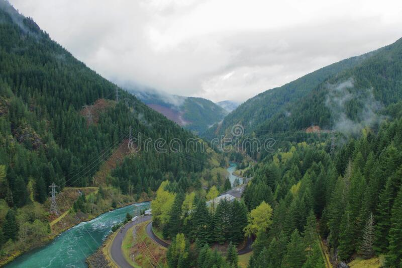 Cascades Mountains, Oregon, Pacific Northwest, USA - Santiam River Valley below Detroit Dam. Low rain clouds hang in the valley of the Santiam River in the stock photography