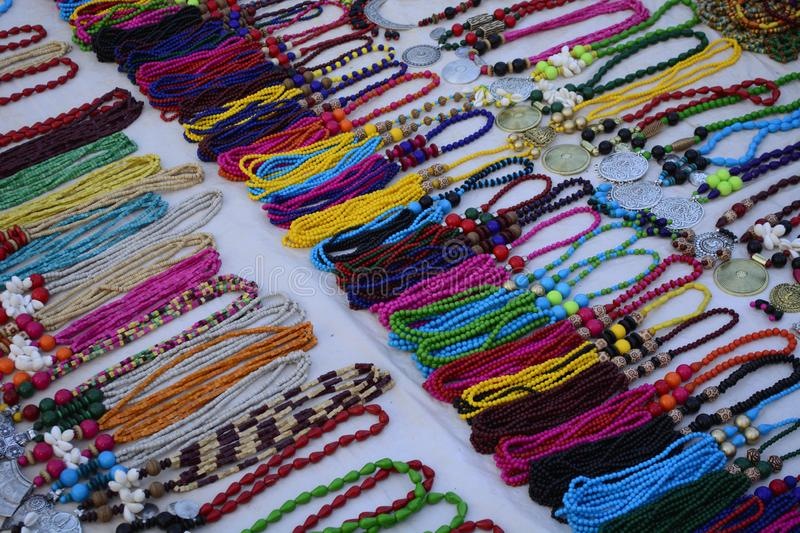 The coloured necklaces on sale in the fare of shantiniketan. Santiniketan or bolpur is a place in bengal India famous for hand made crafts. These are colourful royalty free stock photo