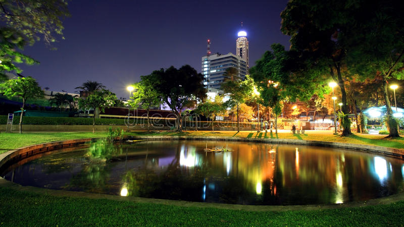 Santipap Park with skyline reflection on the pond at dusk royalty free stock photo