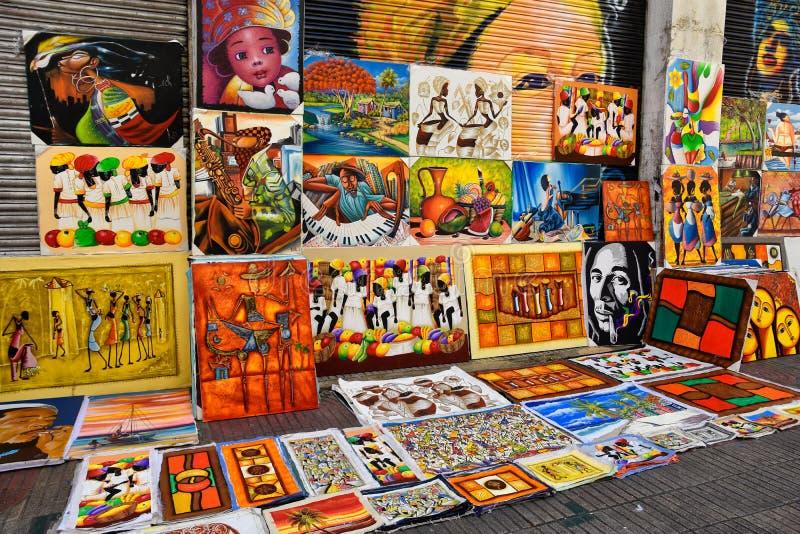 Santo Domingo, Dominicaanse Republiek Caraïbische die verf in Calle el Conde, als herinneringen wordt verkocht stock foto