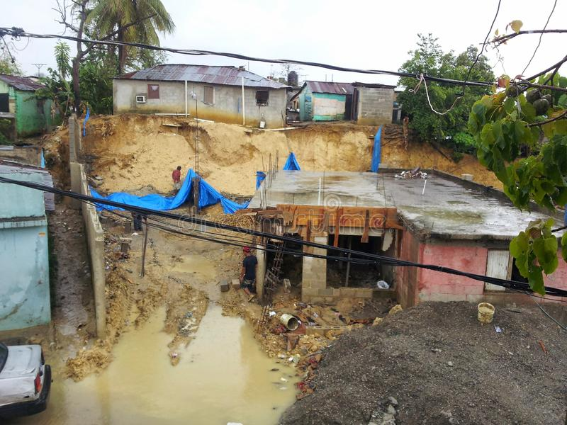 SANTO DOMINGO, DOMINICAN REPUBLIC - MAY 30, 2013: Collapse by storm in a poor neighborhood of Santo Domingo. In Dominican Republic royalty free stock image