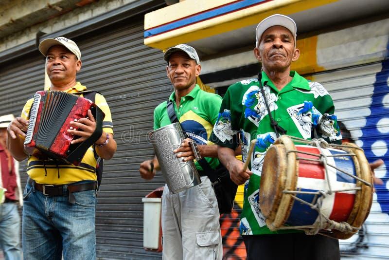 Santo Domingo, Dominican Republic. Merengueros in Calle el Conde, Colonial Zone. Santo Domingo, Dominican Republic. Merengueros in Calle el Conde, Colonial Zone stock photo