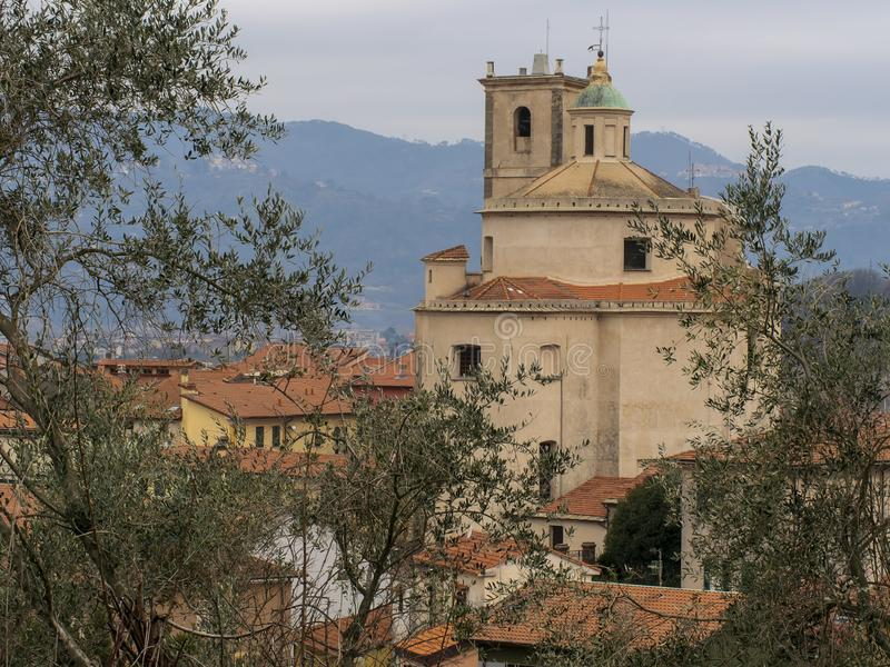 Santo Stefano Magra church and houses in the Lunigiana area of north Tuscany, Italy in La Spezia province. Vertical shot. Santo Stefano Magra church and houses royalty free stock photos