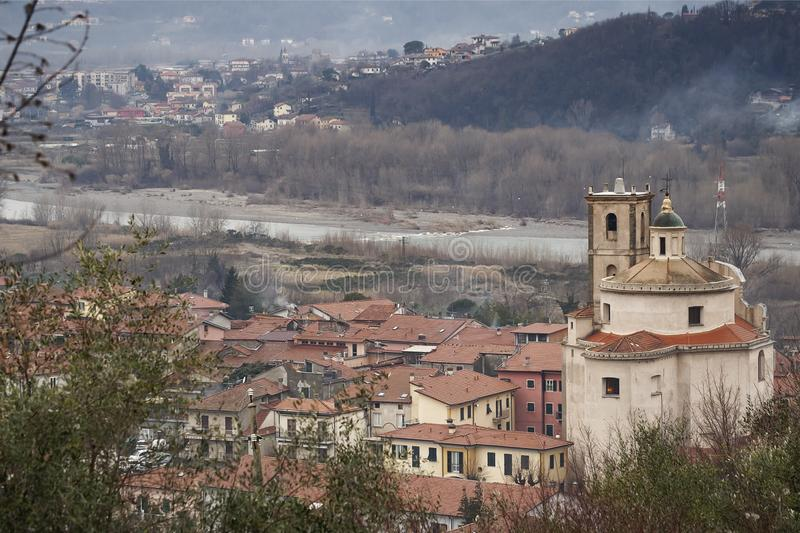 Santo Stefano Magra in Lunigiana area of Italy in La Spezia province. Church, houses and River Magra. Wintry day. Santo Stefano Magra in Lunigiana area of Italy stock images