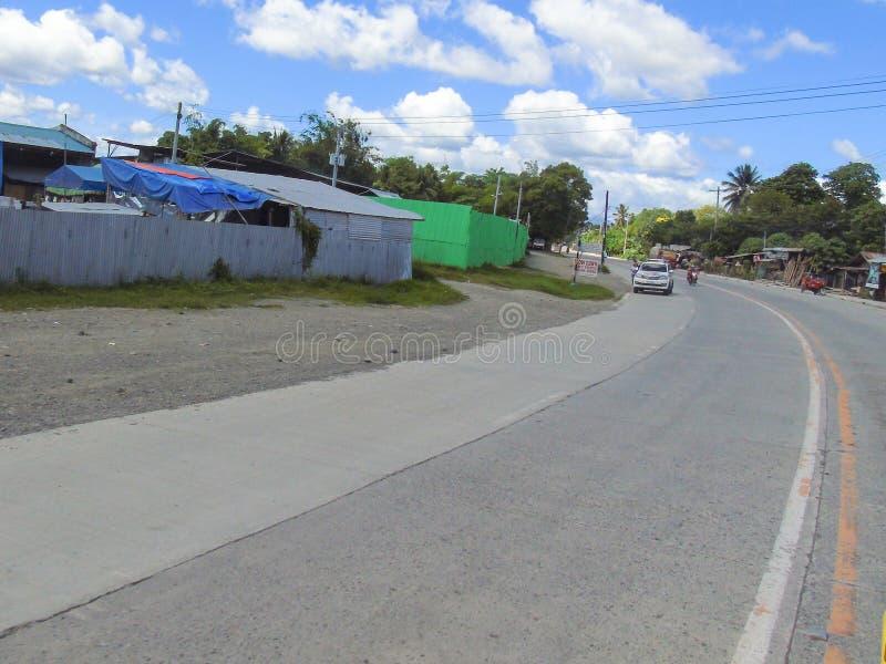 Santo Tomas - Carmen Road com formação bonita das nuvens foto de stock royalty free