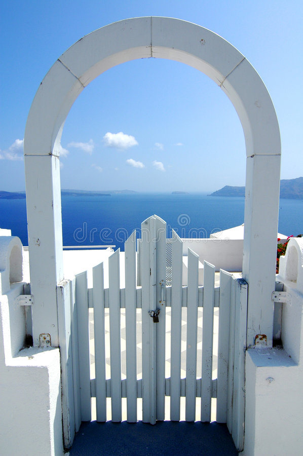 Santorini Archway View. View of water off Santorini in the Greek Islands, through a gated archway stock photo