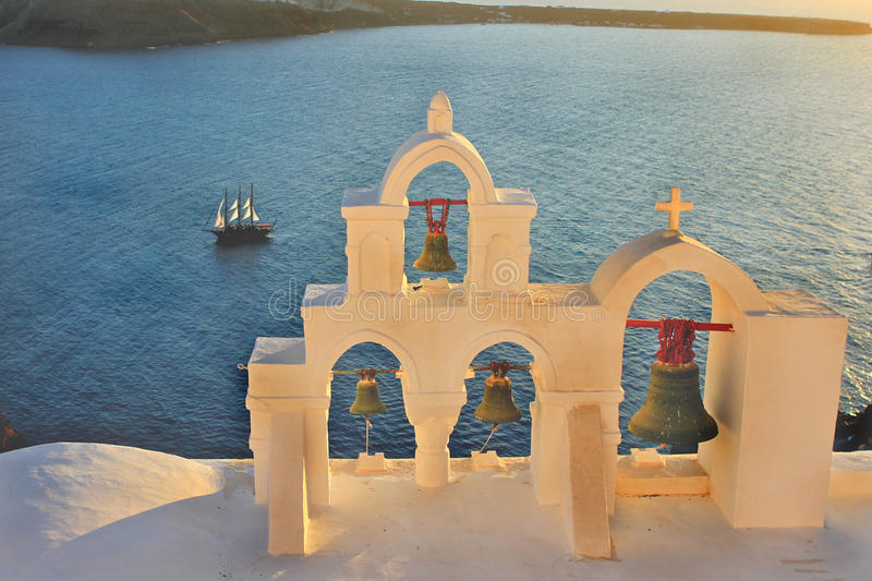 Santorini Bell towers at sunset royalty free stock image