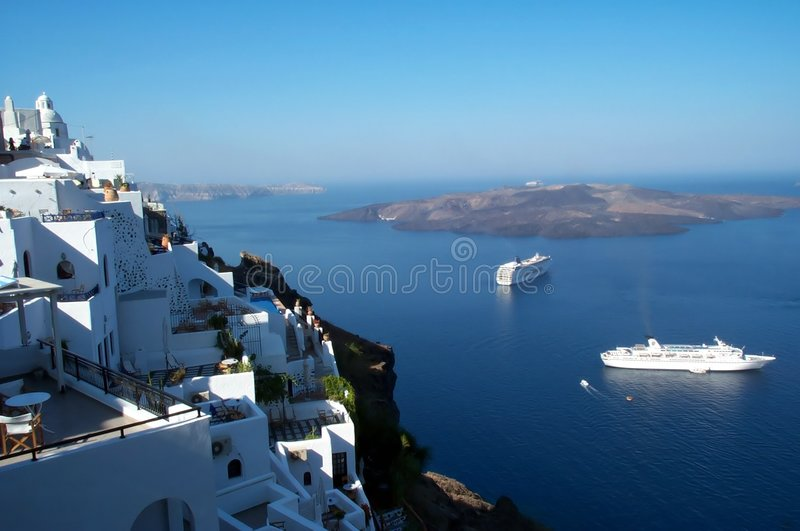 Santorini - caldera view. Thira, the capital of Santorini island. Dark red volcanic soil against the white of the traditional greek architecture royalty free stock photography