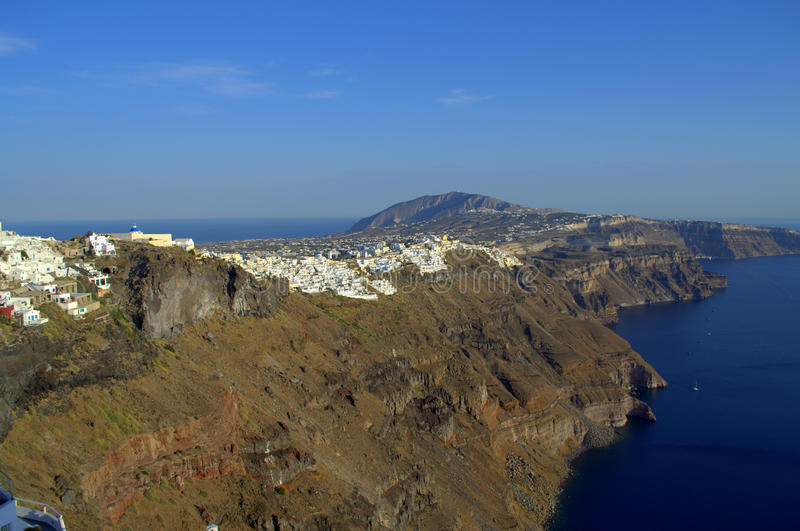 Santorini coastline. Picture taken at Imerovigli,Santorini,Greece during my unforgettable vacation at this heavenly place. Opposite is seen the capital Thira royalty free stock photography