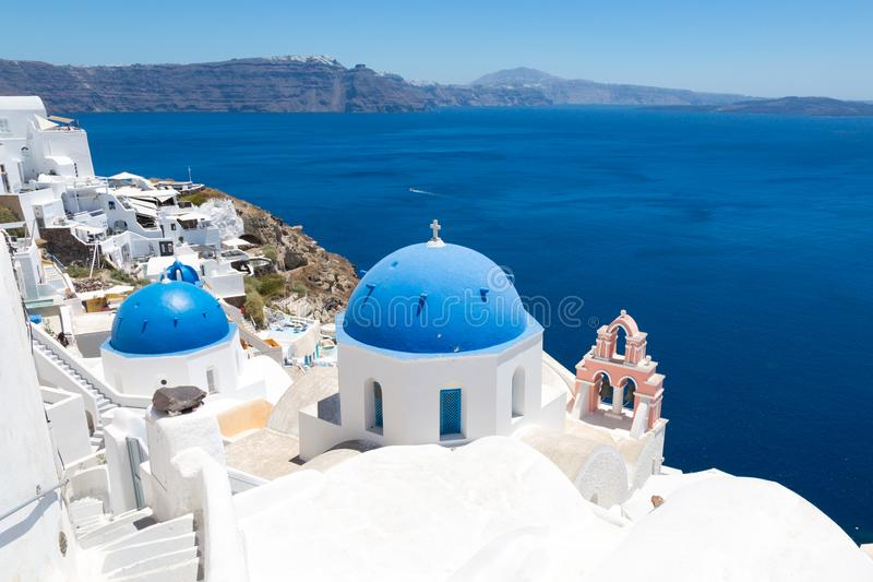 Santorini, Crete, Greece : a white staircase and wall leads to the orthodox church. Blue dome of the church against stock images