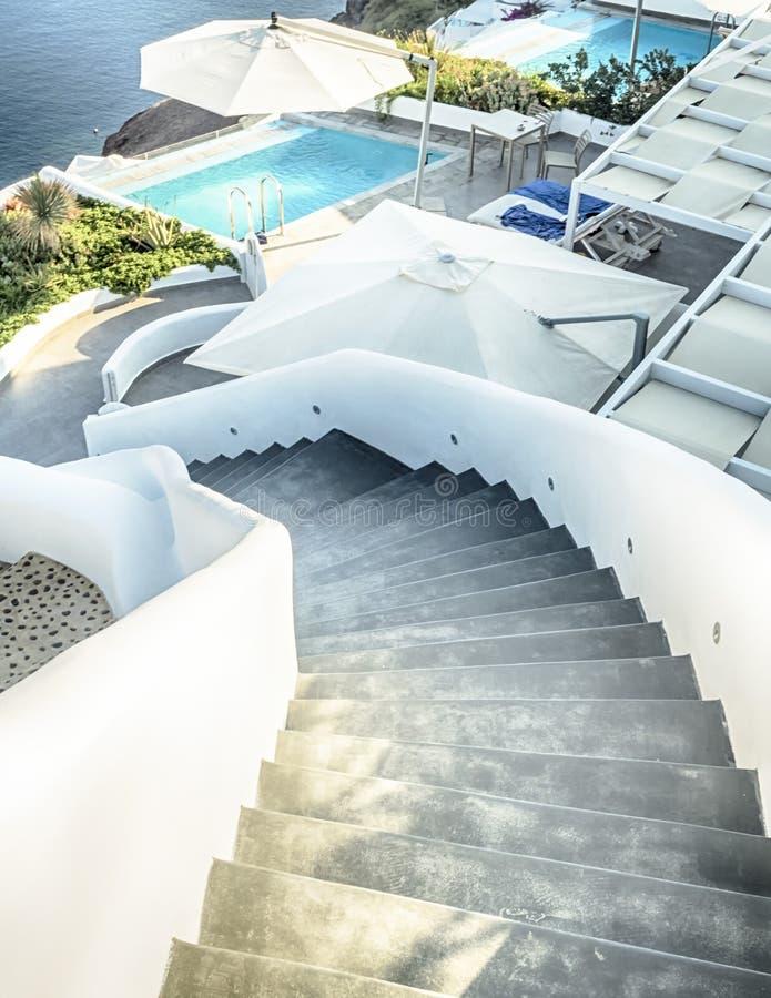 Santorini curly stars and swimming pool, Greece stock photos