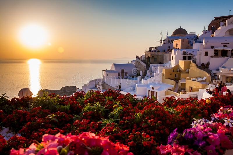 Tourists looking at the amazingly beautiful sunset at La Caldera in Oia city in Santorini Island royalty free stock photography