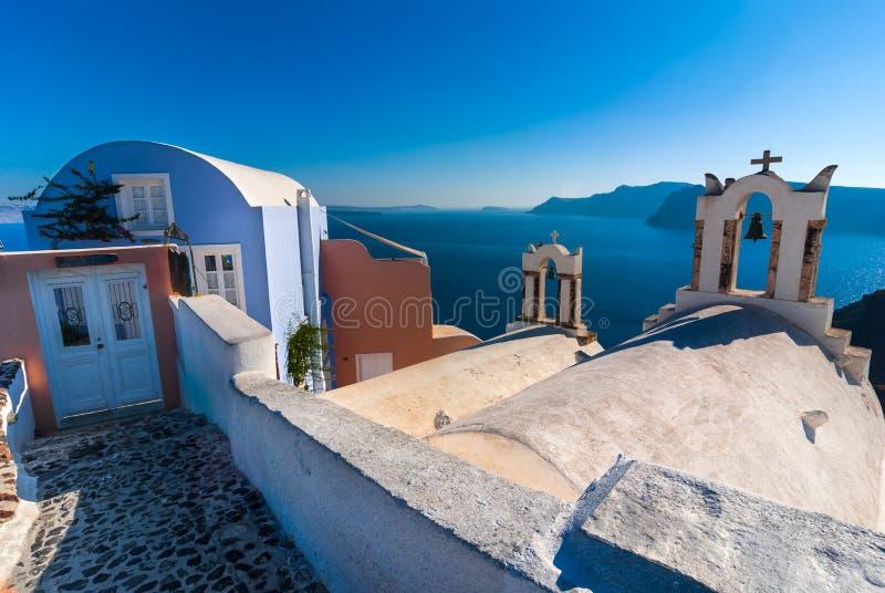 Santorini, Greece. Architecture detail in Oia with Aegean Sea in background, Greek Islands landmark of Mediterranean Sea royalty free stock photo