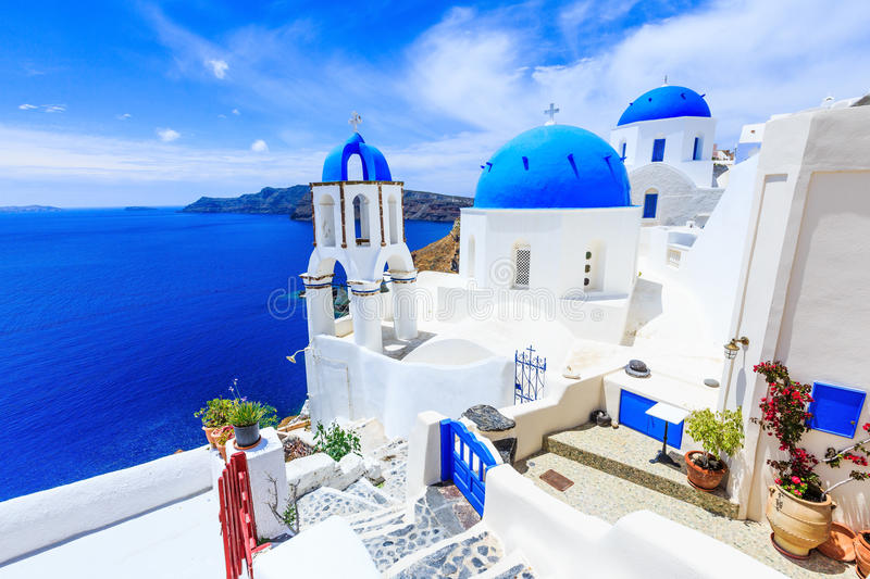 Santorini, Greece. Blue dome church on the village of Oia