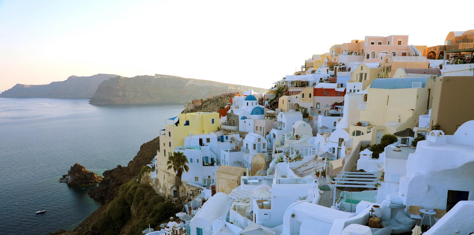 SANTORINI, GREECE - JULY 19, 2018: Stunning panoramic view of Santorini island with white houses and blue domes on famous Greek royalty free stock image