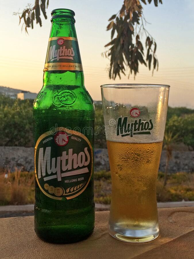Mythos Hellenic Greek Beer Bottle and Glass royalty free stock image