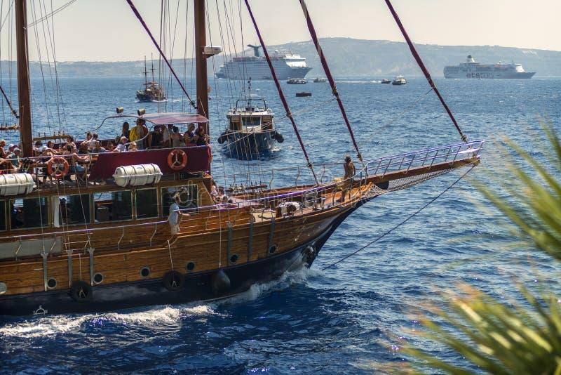 SANTORINI, GREECE - JUNE 30: Touristic ships in the harbor on June 30, 2014 in Santorini, Greece.  royalty free stock photos
