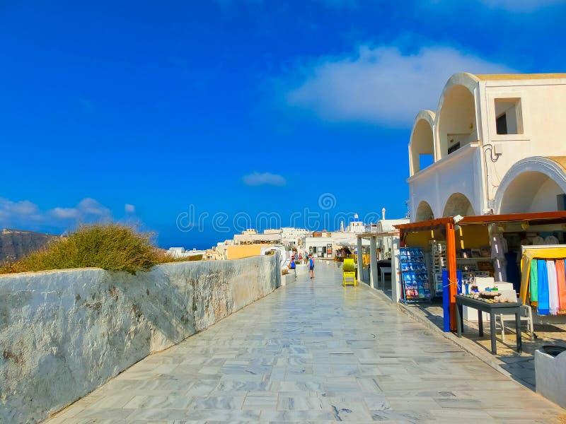Santorini, Greece - June 10, 2015: Tourists doing shopping on June 10, 2015 in Oia town. On the Santorini island, Greece stock photos