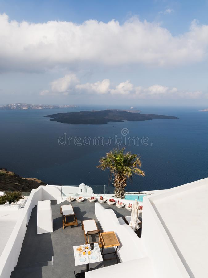 SANTORINI, GREECE - MAY 2018: View over Aegean Mediterranean sea and volcano caldera with luxury hotel and infinity swimming pool stock images
