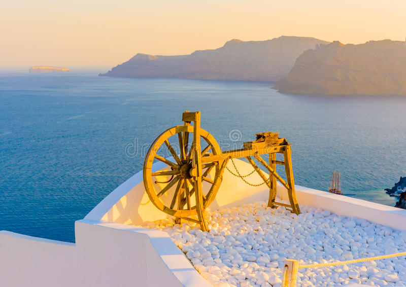 In Santorini island in Greece. Beautiful wooden old tool as a decoration on a terace in Oia the most beautiful village of Santorini island in Greece stock image