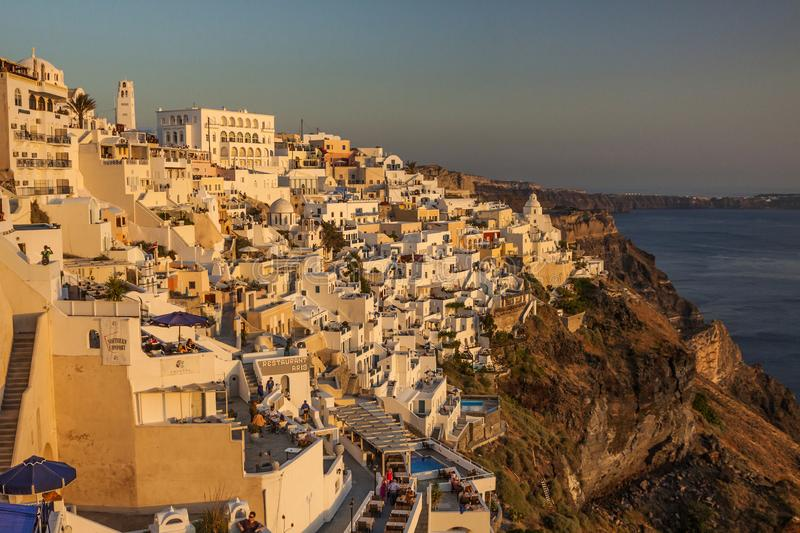 SANTORINI ISLAND, GREECE - JUNE 09, 2009: Beautiful panoramic view of fabulous Thira town with traditional white houses. Picturesque located on the Aegean sea royalty free stock photography
